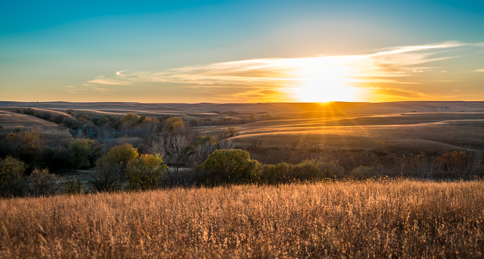 A sunset in the fall in the Flint Hills