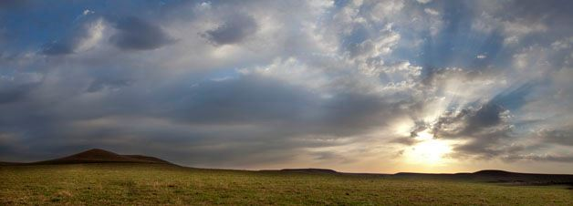 The sun setting over the flint hills landscape