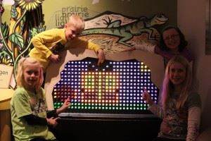 Children playing on an interactive light board